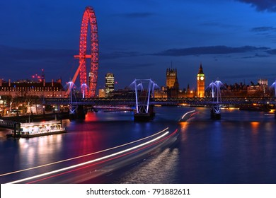 LONDON, UNITED KINGDOM - MAR 31 2017: London Cityscape at Twilight include Famous Landmark; Big Ben, Jubilee Bridge, and London Eye with Light Trails of Boat in Thames River View from Waterloo Bridge