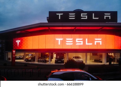 LONDON, UNITED KINGDOM MAR 8, 2017: Tesla Motors showroom with multiple luxury Tesla cars inside. Tesla is an American company that designs, manufactures, and sells electric cars