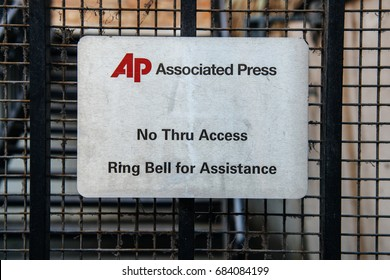 LONDON, UNITED KINGDOM - MAR 9, 2017: Associated Press - the international Press Agency security door entrance with message No Thru Access and Ring Bell for Assistance.
