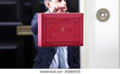 London, United Kingdom - March 03 2021: Chancellor of the Exchequer Rishi Sunak holds the red dispatch box outside 11 Downing Street ahead of revealing the budget in the House of Commons.