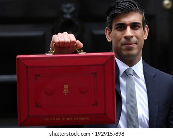 London, United Kingdom - March 03 2021: Chancellor of the Exchequer Rishi Sunak hold red box outside 11 Downing Street before leaving for House of Commons to reveal the budget.