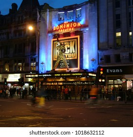 London, United Kingdom - March 08 2004:   Traffic passes under the Statue of Freddie Mercury outside the Dominion Theatre during the run of Queen and Ben Elton Musical We Will Rock You