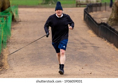 London, United Kingdom - March 15 2021:  Boris Johnson spotted running in a London Park
