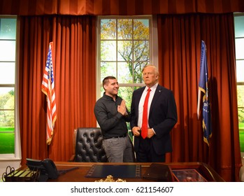 London, United Kingdom - March 17, 2017: Donald Trump wax figure at Madame Tussauds London and praying man