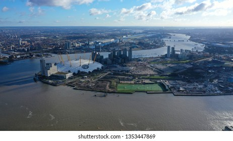 London / United Kingdom - March 18 2019: Aerial drone bird's eye view of iconic concert Hall of O2 Arena in North Greenwich Peninsula