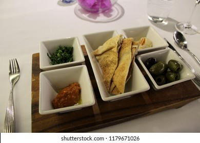 LONDON, UNITED KINGDOM – MARCH 20 2018: Qatar Airways serves its signature starter, Arabic Mezze, for first class passengers in the Qatar Premium Lounge at London Heathrow, from the a la carte menu.
