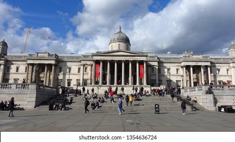 London / United Kingdom - March 20 2019: Photo from iconic art gallery in Trafalgar square in the heart of London with beautiful clouds and deep blue sky