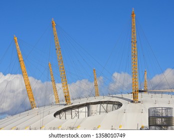 London / United Kingdom - March 20 2019: Extreme zoom photo of iconic O2 Arena in North Greenwich with beautiful clouds and blue sky
