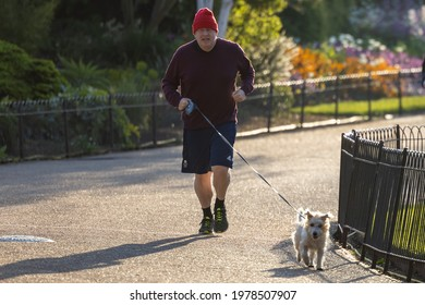 London, United Kingdom - March 20 2021: Boris Johnson spotted running in a London Park with his dog