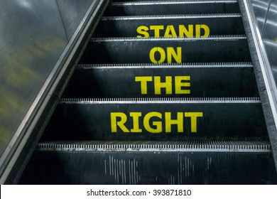 London, United Kingdom - March 20, 2016: Stand on the right notice on an escalator in London Underground, Euston Station