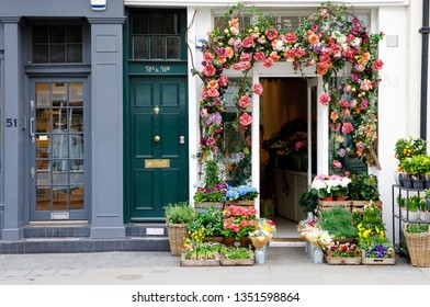 LONDON, UNITED KINGDOM - MARCH 27th, 2017: Florist shop is decorated with flowers on stylish Elisabeth Street. Located beside Chelsea, this part of central London has retained its village ambience.