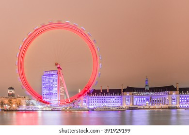 London, United Kingdom - March 3, 2016: Thames river at night with the London Eye, panoramic view of London at night.