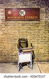 London, United Kingdom - March 3, 2016: This is the British Rail homage to Harry Potter at Kings Cross station in London England. A half trolley is embedded in the wall.
