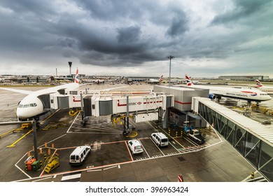 London, United Kingdom - March 5, 2016: British Airways jumbo jet aeroplanes at Heathrow Terminal 5 on a stormy day.British Airways is the largest airline in the United Kingdom.