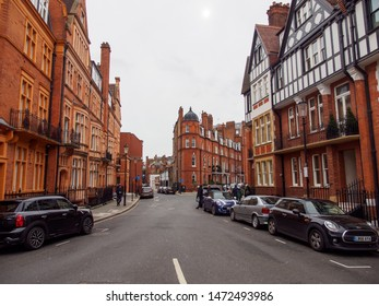 LONDON, UNITED KINGDOM - MARCH 8, 2019: Wide angle view of the red brick gabled houses and buildings of Pont Street, Knightsbridge, on a cloudy day. Travel and tourism.