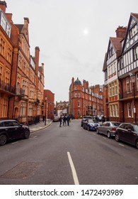 LONDON, UNITED KINGDOM - MARCH 8, 2019: Wide vertical view of the red brick gabled houses and buildings of Pont Street, Knightsbridge, on a cloudy day. Travel and tourism.