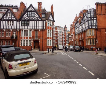 LONDON, UNITED KINGDOM - MARCH 8, 2019: Wide view of the Victorian era red brick gabled houses and buildings along Pont Street, Knightsbridge, on a cloudy day. Travel and tourism.
