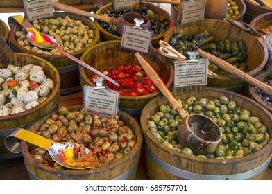 LONDON, UNITED KINGDOM - MAY 08, 2014: Wooden containers with olives seasoned in different styles, at a fast food stall in Portobello street market
