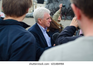 London, United Kingdom - May 1 2017: John McDonnell MP addresses journalists at the 2017 May Day parade in Trafalgar Square, London.