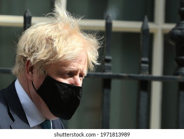 London, United Kingdom - May 11 2021: UK Prime Minister Boris Johnson leaves 10 Downing Street ahead of state opening of the parliament.