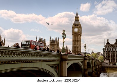 LONDON, UNITED KINGDOM - MAY 11 - London's Parliament Bridge with unidentified tourists and traffic passing by with Big Ben in the background, 2012.