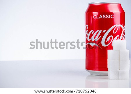 London, United Kingdom - May 11, 2017. Can of Classic Coca-Cola with Sugar Cubes. Classic Cola has approximatley seven teaspoons of sugar per 330ml can.