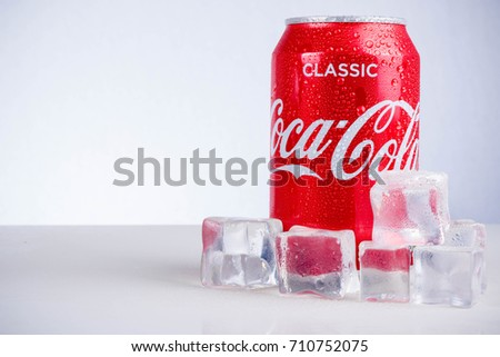London, United Kingdom - May 11, 2017. Can of Classic Coca-Cola and ice cubes. Classic Cola has approximatley seven teaspoons of sugar per 330ml can.