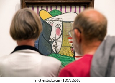 LONDON, UNITED KINGDOM - MAY 12: Visitors looking at Pablo Picasso painting Bust of woman at Tate modern on May 12, 2018 in London