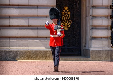 London / United Kingdom - May 12 2019: Ceremony of Changing the Guard on the forecourt of Buckingham Palace