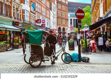 LONDON, UNITED KINGDOM - MAY 13 2018: London tricycle taxi availble for tourist in the inner area of city of London and the city of Westminster