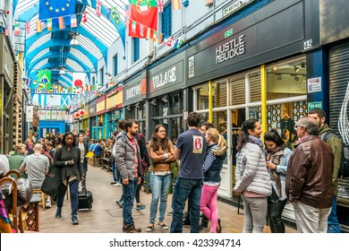 London, United Kingdom - May 14, 2016: Brixton Village and Brixton Station Road Market. Colorful and multicultural community market run by local traders in South London. Restaurants