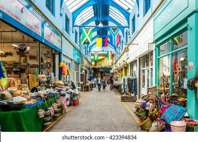 London, United Kingdom - May 14, 2016: Brixton Village and Brixton Station Road Market. Colorful and multicultural community market run by local traders in South London.