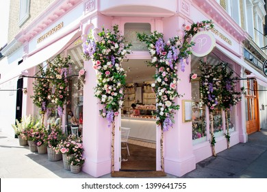 LONDON, UNITED KINGDOM - MAY 15th, 2019: Stylish cake shop  in upmarket Chelsea is decorated with floral spring theme