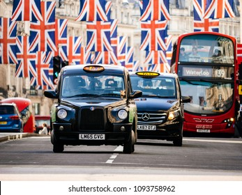 LONDON, UNITED KINGDOM - MAY 18, 2018: Taxi cabs and buses under Union Jack Flags on Regent Street a day before Royal Wedding. The Royal Wedding between Prince Harry and Meghan Markle Windsor Castle