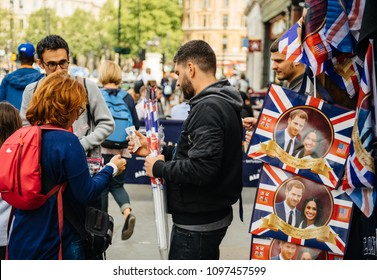 LONDON, UNITED KINGDOM - MAY 18, 2018: Tourists buying from shop souvenir memorabilia royal wedding celebration a day before Windsor Castle Meghan Markle Prince Harry marriage