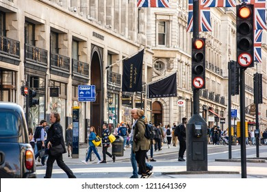 LONDON, UNITED KINGDOM - MAY 18, 2018: Perspective view with telephoto lens over Regent Street in london with Burberry flagship store and pedistrians