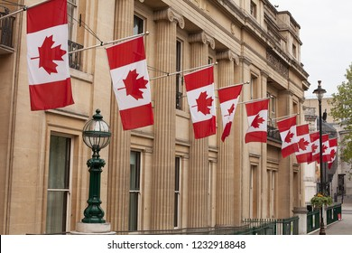 London, United Kingdom, May 19, 2013: Canada House on Trafalgar Square, London. Embassy of Canada in England with Canadian flags flying on the exterior of the building