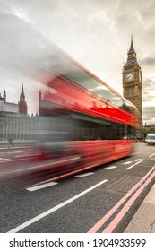 London, United Kingdom - May 2016: London Famous Double Decker Bus Blurred From Motion on Westminster Bridge Overlooking the Big Ben Tower Clock and Westminster Palace