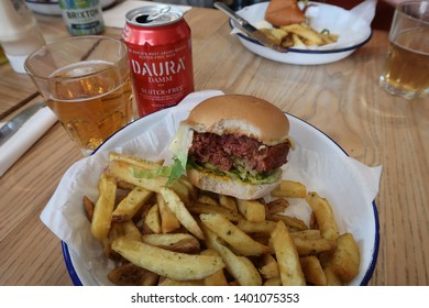 London, United Kingdom - May 2019: Gluten-free Beyond Meat burger and fries at Honest Burgers Oxford Circus