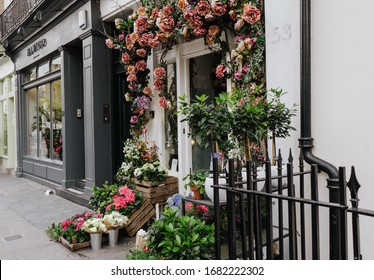 LONDON, UNITED KINGDOM - MAY 20th, 2019: Shop decorated with flowers in Belgravia, London. Chelsea in Bloom season.