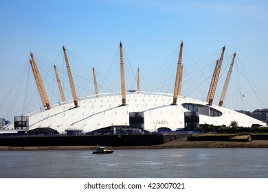 London, United Kingdom, May 27, 2012 : The Millenium Dome approaching from the River Thames. Now known as the O2 Concert Hall, popular for it's live music acts