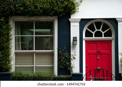 London, United Kingdom - May 5 2017: Colorful red and blue door of London home