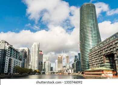 London, United Kingdom - November 07, 2018: View from Greenwich View Place towards Baltimore Tower, Lotus Floating Chinese restaurant, Wood Wharf, and Millwall Dock