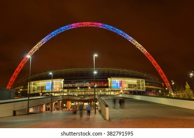 London, United Kingdom - November 15, 2015 : Brightly colored lit Wembley Stadium at dusk. Wembley Stadium is a football stadium in Wembley Park, London, England, which opened in 2007.