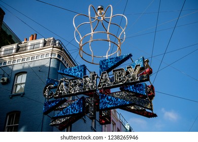 London, United Kingdom, November 17th 2018:- Sign above Carnaby Street in the Soho area of London, famous since the 1960s for its independent fashion shops.