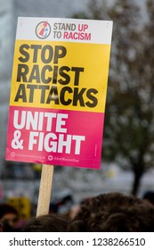 London, United Kingdom, November 17th 2018:- Placards at the Stand Up To Racism march through central London from the BBC to near Downing Street in Whitehall