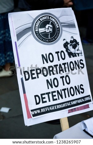 London, United Kingdom, November 17th 2018:- Anti deportation placard at the Stand Up To Racism march through central London from the BBC to near Downing Street in Whitehall