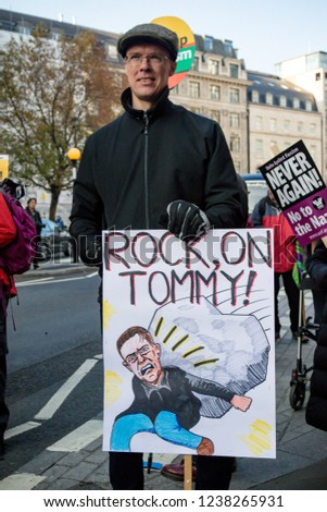 London, United Kingdom, November 17th 2018:-  A protester with an anti Tommy Robinson sign at the Stand Up To Racism march through central London from the BBC to near Downing Street in Whitehall