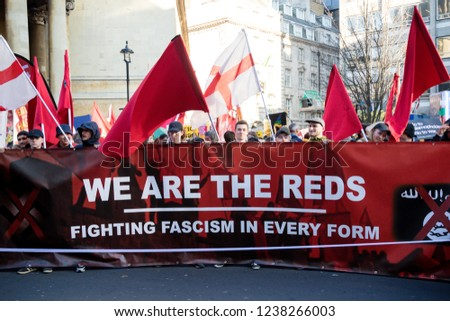 London, United Kingdom, November 17th 2018:- Reds at the Stand Up To Racism march through central London from the BBC to near Downing Street in Whitehall