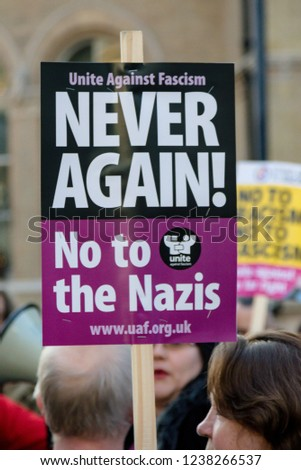 London, United Kingdom, November 17th 2018:- An anti Nazi sign at the Stand Up To Racism march through central London from the BBC to near Downing Street in Whitehall